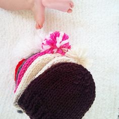 WEBSTA @ sparklytwig - Pudgie baby toes make the best photo bombs! Today was spent finishing up these cozy hats