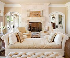 Welcoming Attitude - Light, airy, and romantic, this European-inspired interior features a linen-and-velvet chaise, a cozy fireside, and splendid outdoor views. The relaxed neutral palette lets the interesting antique pieces speak for themselves.