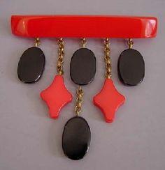 BAKELITE black and red dangles pin