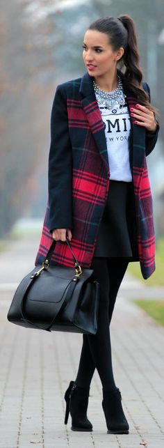 Plaid coat, black high heels, tights and hand bag create ellegant and graceful look.