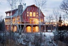 I love how they used old red barn wood on the exterior of this restored barn.