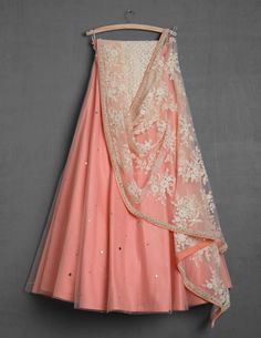 A lovely peach and white lehenga design with net overlay and sheer dupatta with white embroidery. Would be great for a friend's wedding!