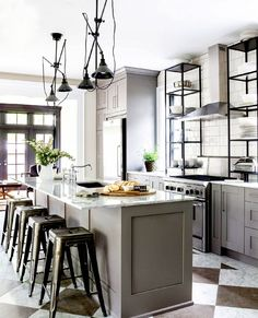 Stunning Ikea Kitchens.  Gray and white with marble.  Love the black door and the bar stools.