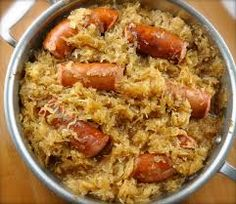 Polish Kapusta- 1 small chopped cabbage, 3 sliced onions, 1L jar Saurkraut (liquid drained) , 3 tbsp. honey, sliced Kolbasa Sausage, 2-3 tbsp. flour, Butter, Garlic powder, S&P. -----Fry onion in butter until golden, add cabbage & Sauerkraut & cook until soft.  Add  chopped sausage & spices- cook 10 minutes longer.  Brown 2-3 tbsp. of white flour on a dry frying pan, then sprinkle into Kapusta stiring until blended. A variation would be to add mushrooms or bacon instead of sausage.