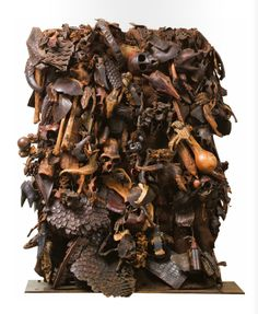 Africa | Sorcerer's tunic from Cameroon | Accumulation on both sides of a fabric surface of skulls, bones, wood, charms, leathers, skins, scales, metals, barks, birds legs and other diverse materials  || Source; page 196 ~ issuu.com/...