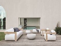 Upholstered garden armchair with armrests CLAUD | Armchair by Meridiani
