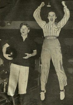 Judy Garland bowling with Mickey Rooney. (1940)