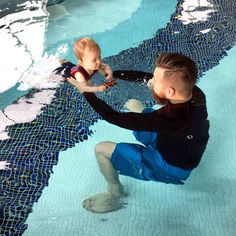 Father and Baby Daughter Swimming Together