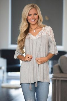 This sweet blouse combines vintage style and today's trends for a beautiful new addition to your wardrobe! Featuring soft heathered material in a lovely shade of grey/blue, this soft and feminine colo