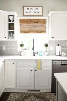 modern farmhouse kitchen with grey subway tile backsplash, white cabinets and bamboo shade on window over sink Gray Subway Tile Backsplash, Grey Subway Tiles, Rustic Backsplash, Subway Tile Kitchen, Kitchen Backsplash, Kitchen Sink, Backsplash Design, Granite Backsplash, Kitchen Cabinets