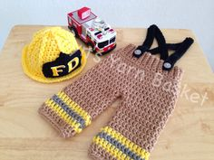 This is an adorable suit for your little fireman! Set includes pants with suspenders, fireman hat and 2 boots. This set would also make an adorable photo prop, baby shower gift, pregnancy announcement or perfect for your gender reveal party! This set is made with very soft acrylic yarn in toasted almond, black, yellow & smoke gray. The buttons are sewn on securely to the pants. Fire truck is not included.  ***Customize your set with your name! Name now available on the butt of the diaper…