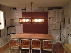 Dining room with ancestry wallpaper, reclaimed cranberry crate lighting fixture with Fracture printed ancestor photo glass