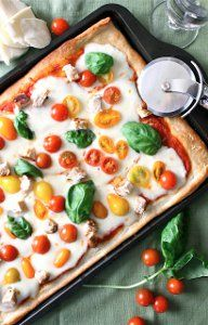 This luxuriously light pizza recipe is the perfect snack or appetizer for meals at home. Fresh ingredients are the key to this Chicken Caprese Pizza.