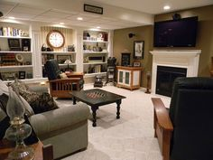 We removed the out-of-date built-in media center and installed an electric fireplace with 50 inch plasma above. No windows in this basement so it is great for w…