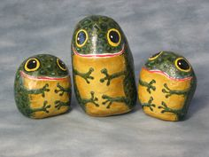three friendly frogs