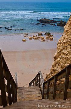 Wooden steps to Praia da Rocha an the Atlantic Ocean in Algarve, southern Portugal.