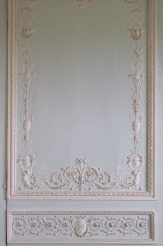 """Boiserie detail on the wall of the """"Cabinet of Movable Mirrors, the boudoir, Le Petit Trianon. Commissioned in 1787."""