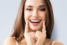 smiling woman with teeth crowns