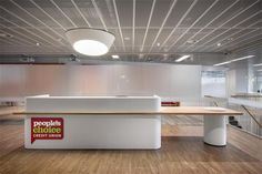 Woods Bagot has designed the new offices of People's Choice Credit Union in Adelaide, Australia. Woods Bagot collaborated with People's Choice to create a Visual Merchandising, Artificial Marble, Reception Furniture, Reception Counter, Signage Design, Wayfinding Signage, Branding, Design Furniture, Stores