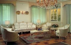Interior Design Style: French living room ✦ Characteristics: Rich details; extensive use of gold, bronze, and gilt; one color carried throughout space; French royal style antiques or heirlooms; dramatic layered window treatments in focal color; flowers; ornate, fanciful, and decorative.