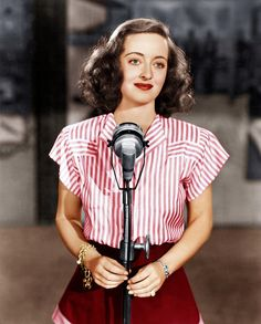 """Studio portrait for wartime film Hollywood Canteen (1944) - Bette contributed to the war effort by selling war bonds; after Jack Warner criticized her tendency to cajole crowds into buying, she reminded him that her audiences responded most strongly to her """"bitch"""" performances, and she went on to sell two million dollars worth of bonds in two days..."""