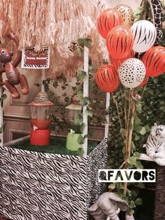 Love the decor at a Jungle party!  See more party ideas at CatchMyParty.com!  #partyideas #jungleparty