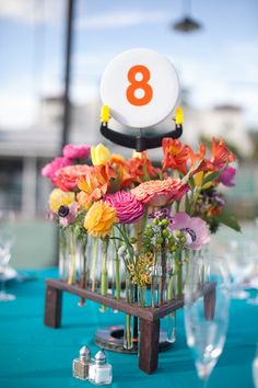 How adorable (and fun!) are these colorful centerpieces? {roohi photography}