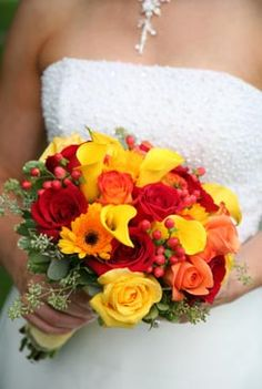 red and yellow roses nosegay bouquet with orange marigolds and yellow calla lillies