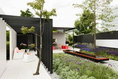 Garden Trend 2013 – Garden Design 'Let Me Glow' Garden – Modern Garden in Symmetry with Fluo Coloured Design Garden Furniture and Accessories. Modern Terrace with Japanese Plants and Trees Influences.