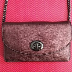 """Coach metallic cherry crossbody NWT Metallic cherry leather clutch crossbody, with 20"""" drop chain strap. Approx measure 7x4.5"""", 1 zipper compartment, 4 pockets, 3 card holders, small scratches on front lock as shown in photo 3. PRICE FIRM Coach Bags Crossbody Bags"""