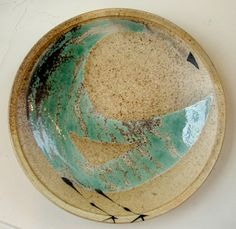 porcelainbedelia: Brooklyn Pottery      Plate by Sam Taylor    Love Sam's work- especially his strange bird, fish, and skull designs. His wood fired and salt glazed surfaces are fantastically earthy.