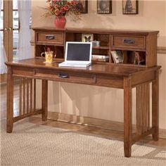 Create a functional atmosphere in your home office where you can complete your daily tasks efficiently. This desk features one center drawer, two top drawers, two shelves, and six cubbyholes or open spaces. #Rifesfurniture #officespace #desk