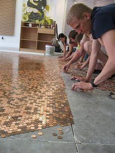 DIY Penny FloorIf you like the look of copper this project may be for you. It does use polyurethane, epoxy sea Inexpensive Flooring, Unique Flooring, Flooring Ideas, Bar En Palette, Indoor Climbing Wall, Man Cave Furniture, Microfiber Couch, Granny Pod, Ultimate Man Cave