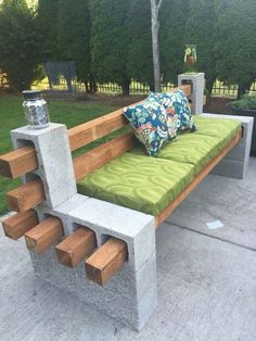 DIY Bench: cinder blocks + 4×4 beams + paint. Use cement adhesive to secure the cinder blocks together.