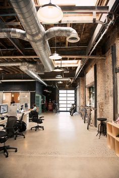 office space | industrial | ducts | exposed brick | open concept