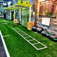 Functional fitness training gym design. Open space for movement, wall mount monkey bar bridge for overhead modalities