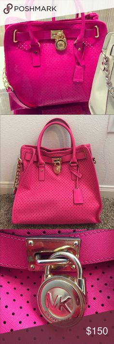 Michael Kors Hot Pink Laser Cut Out Handbag Stunning hot pink color with tiny little holes throughout. Excellent used condition, one small spot on strap (will try and remove) and the front plate shows minor signs of wear. (No key included like the stock photo) Interior will be wiped down before sent. Hard to find color in this design!! Has shoulder strap and hand straps. Feel free to ask any other questions! Michael Kors Bags Satchels