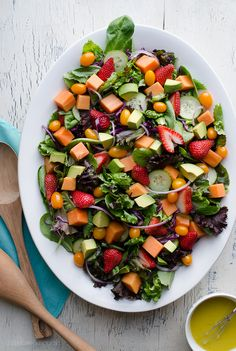 This Strawberry Papaya Salad is loaded with amazing flavors! I love the sweetness from the fruit balanced with the tanginess of the dressing. The added sumac to the lemony vinaigrette enhances the flavors so much. Vegan options. From @tasteLUVnourish on TasteLoveAndNourish.com