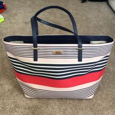 Kate Spade Stripe Tote Super cute tote with red, pink, white and navy stripes. Sold out in stores. Used once. Like new other than a few very faint marks on inside lining. kate spade Bags Totes