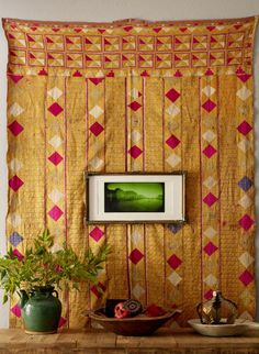 Vintage Phulkari (embroidered tapestry from Punjab, India) onthe wall.   (via sneak peek: paige morse | Design*Sponge)