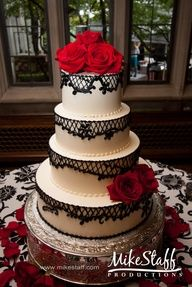 With white lace, sparkles, pearls, and paper book roses