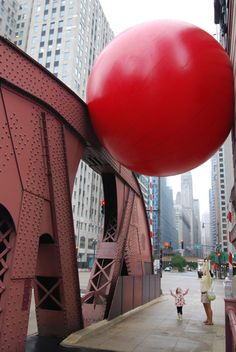 "RedBall Project by Kurt Perschke who says, ""As RedBall travels around the world, people approach me on the street with excited suggestions about where to put it in their city. In that moment the person is not a spectator but a participant in the act of imagination. That invitation to engage, to collectively imagine, is the true essence of the RedBall Project."" photo of LaSalle Bridge, Chicaago/Rex Features via telegraph.co.uk Thanks to @Josh Draper#RedBall_Project #Kurt_Perschke #telegraph_co_uk"
