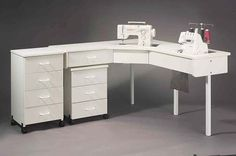 Corner sewing table - like this but with a second angle for the other corner so one machine is in each corner with cutting (or other) space between them and storage cabinets between each.