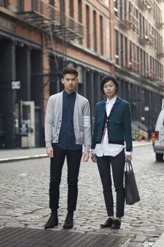 """David wears a classy Thom Browne cardigan and pants/boots by Acne. Julie wears a cute Thom Browne cardigan and shirt, shoes by Jil Sander  and a bag by Valextra."""