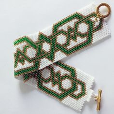 Celtic Band bracelet (odd-count peyote stitch). Made with size 11/0 Delica beads. Design by http://skaior.etsy.com