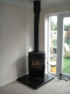 Contura 54 wood burning stove can be positioned near glass.