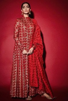 Bollywood actor Sonam Kapoor Ahuja styled in a high-necked all-red Anarkali suit featuring metallic details by Masaba. Vogue India brings you Bollywood inspired Anarkali suits Red Lehenga, Bridal Lehenga, Lehenga Choli, Sonam Kapoor Lehenga, Sonam Kapoor Wedding, Khada Dupatta, Bridal Anarkali Suits, Sabyasachi Sarees, Dress Indian Style