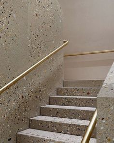 Custom terrazzo stairs in the stores by architects.