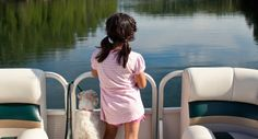 (◔◡◔)  Girl and her attentive buddy enjoy a pontoon boat ride, taking in the scenery. (doggy looks like my WireHair Fox Terrier! :->)  ♥..♥