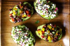 Here is a great idea to revitalize your work week lunches! Avocado cup confetti salads by Smitten Kitchen